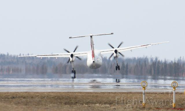 de Havilland Dash 8-100 — - Fighting the x-wind on touchdown