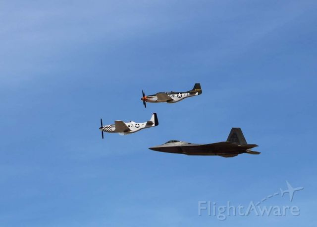 — — - Heritage Flight practice at Davis-monthan AFB Two P-51s in formation with an F-22.