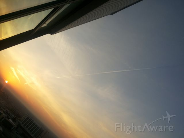 — — - Journey in the shadow, taken fram IKIA tower,sunrise time, the flight at 38000 feet is flying in it
