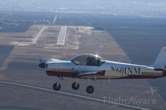 ZENAIR Super Zodiac (N601NM) - Tim Cottam flying his Zodiac. Departure end of Runway 31 visible behind the plane.