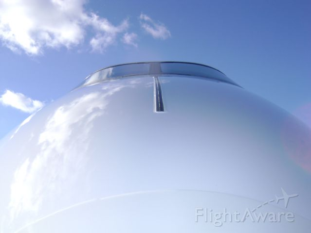 — — - Looking up the nose of a Challenger 300