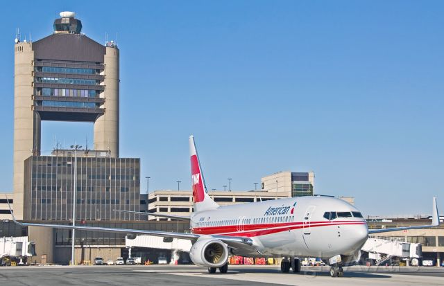 Boeing 737-800 (N915NN) - American Airlines TWA Special retro livery @ KBOS Logan ATC tower