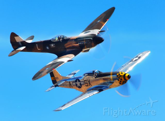 — — - British Spitfire and North American P-51D Mustang fly in formation during Mather field's, Capitol Air Show 2012 in Rancho Cordova, CA.