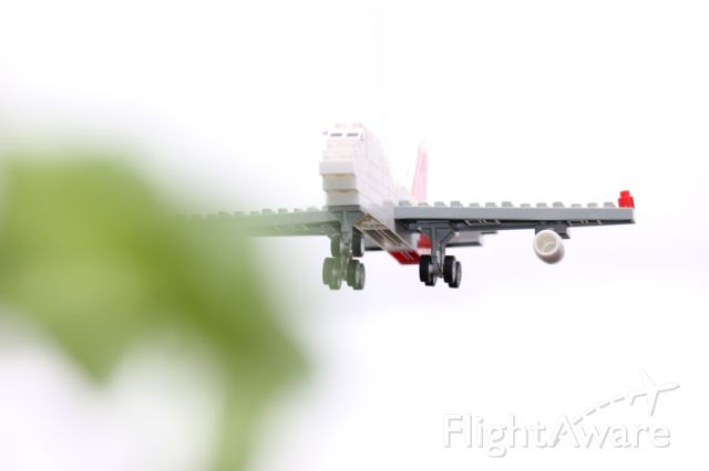 LEGO — - Back yard, for the children, a Lego plane on final approach.