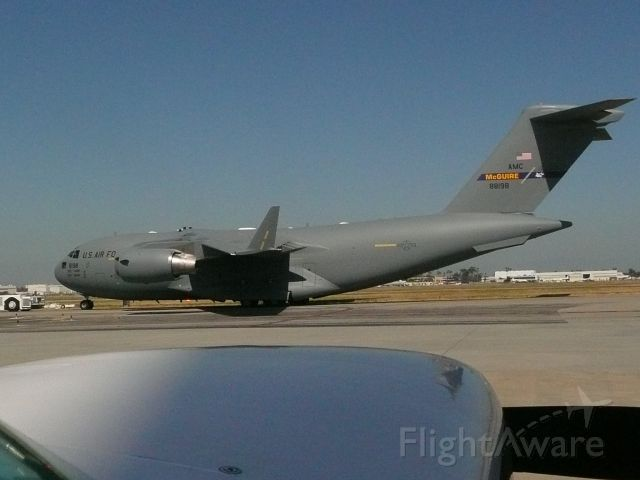 Boeing Globemaster III — - C-17 off the Boeing line at LGB,taken from Mooney 252 fueling at Air Flite