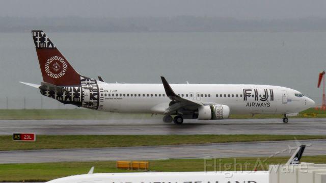 Boeing 737-800 (DQ-FJM) - Fijian 737-800 drying out a soggy runway.