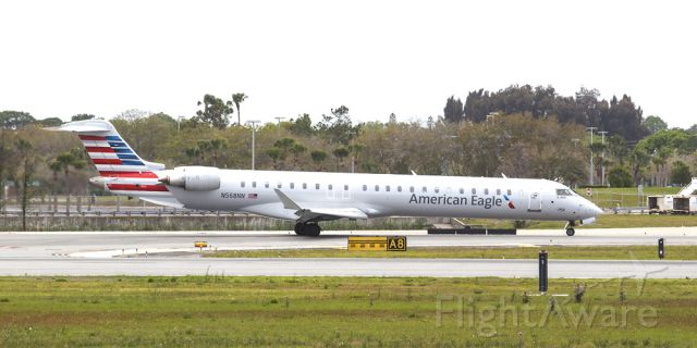 Canadair Regional Jet CRJ-900 (N568NN) - American Eagle taxis to the gate after landing at KSRQ on Easter Sunday 2016.<br />To get a copy of this image go to NotableImages.US