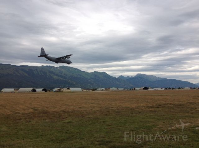 Lockheed C-130 Hercules — - C-130J, just before touchdown in Northern Italy.