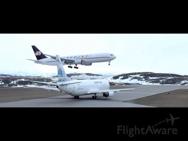 Boeing 737-200 (C-FFNM) - Cargo Jet arriving while First Air 861 waits