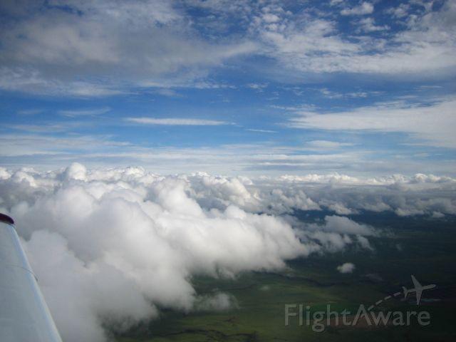 Grumman AA-5 Tiger (N929TE) - Cloud formations over Northern Texas