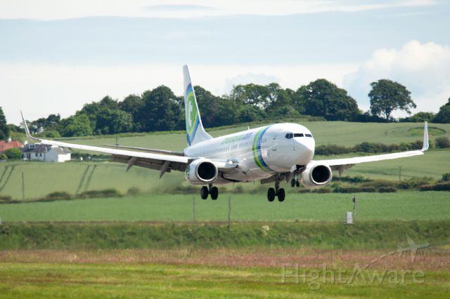 Boeing 737-700 (PH-HZK) - Standing in for the KLM flight landing @ Edinburgh airport photo taken from Almondbank
