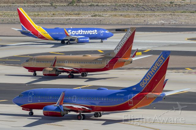 Boeing 737-700 (N7746C) - Three different chapters of Southwest at PHX!