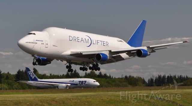 Boeing 747-400 (N747BC) - Dreamlifter N747BC arriving at Paine Field while ANA 787-8 N1015X (temp reg) awaiting depature clearance