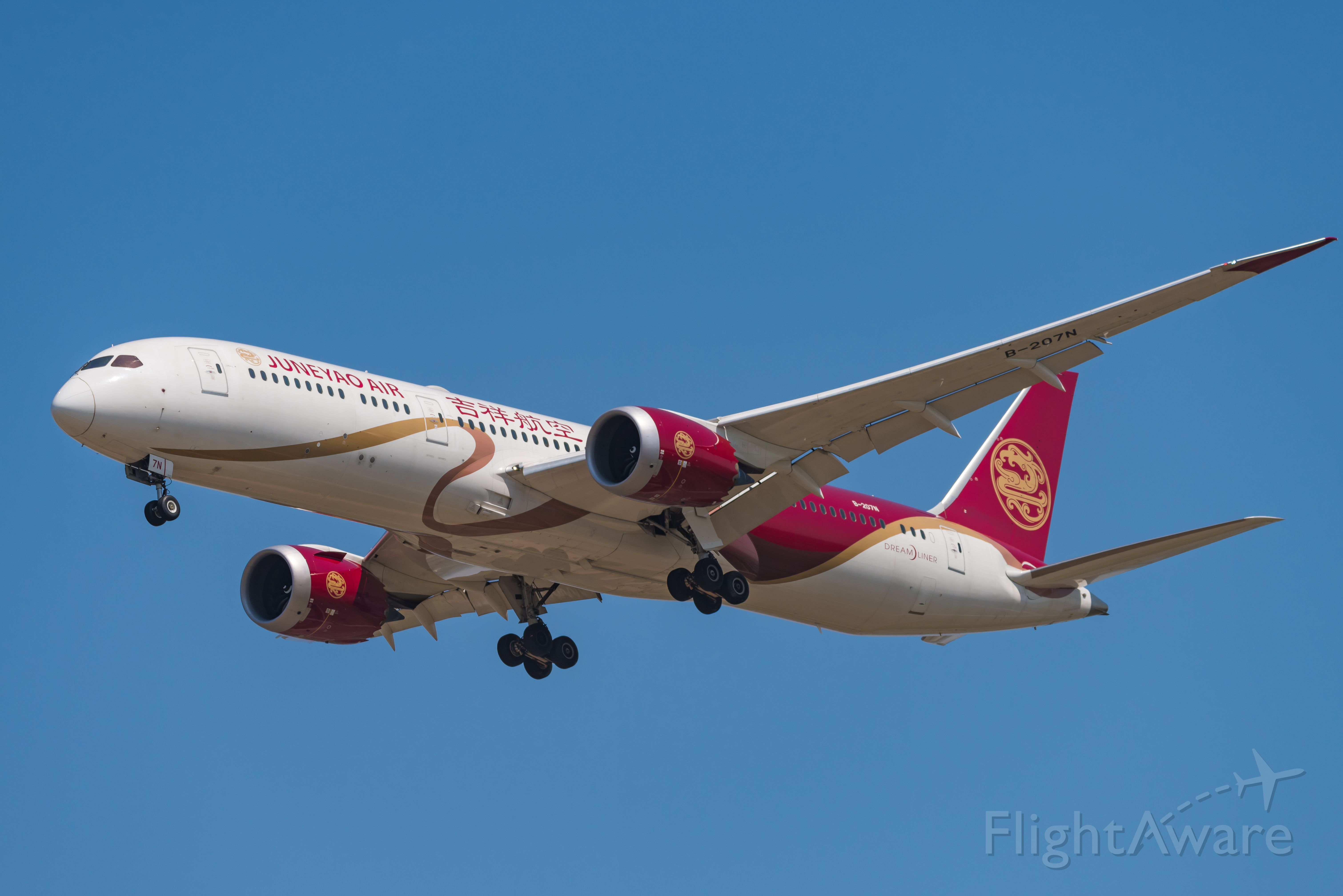 Boeing 787-9 Dreamliner (B-207N) - Juneyao Air's B789 'red ribbon' livery landed at zspd-19.4.12