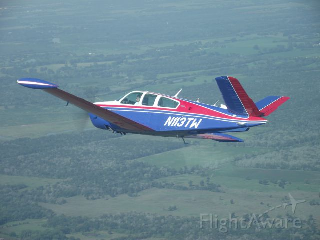 Beechcraft 35 Bonanza (N113TW) - Formation Flying west of KTME