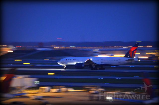 Boeing 777-200 (N702DN) - Taken from the roof of A Concourse during the night shift