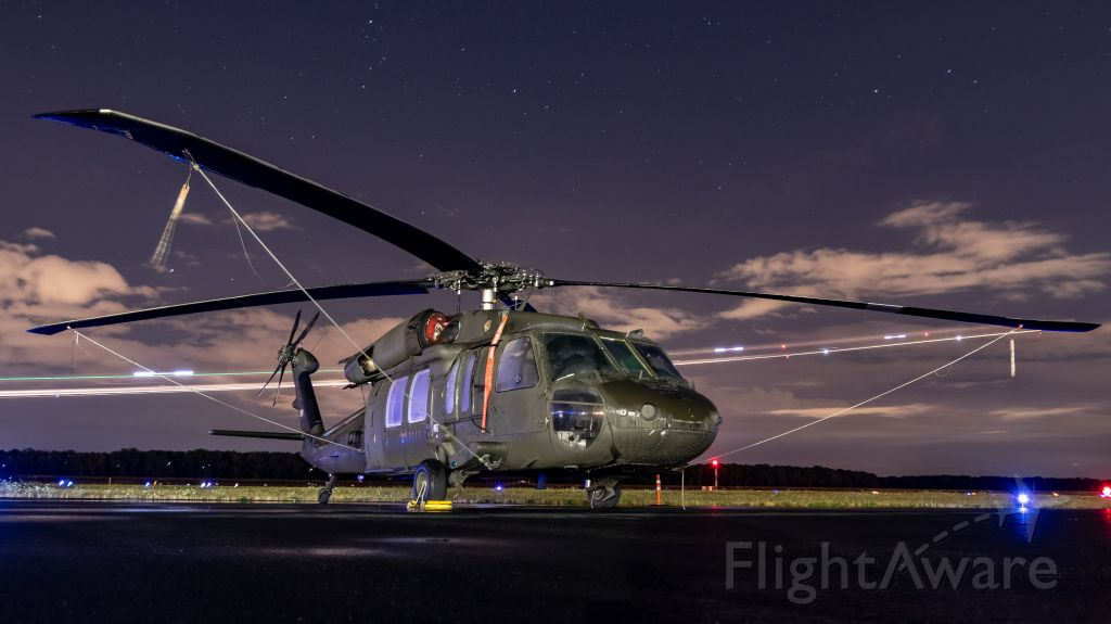 8323898 — - A UH-60L of the US Army sat a wet night at kpdx.