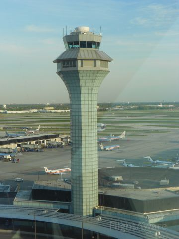— — - View of OHare control tower from ground operations tower.