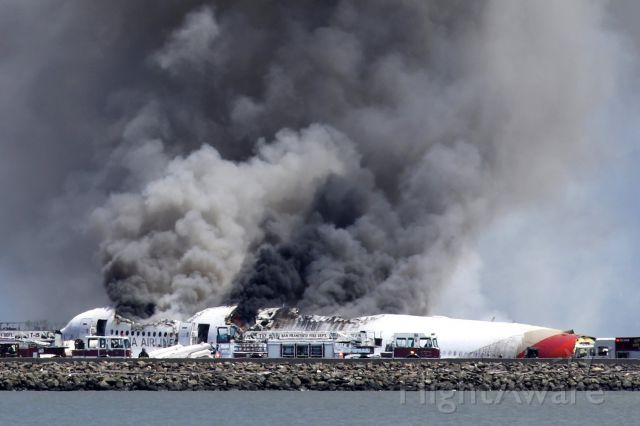 Boeing 777-200 (HL7742) - HL7742 sadly burning not long after it crash landed on rwy 28L at SFO