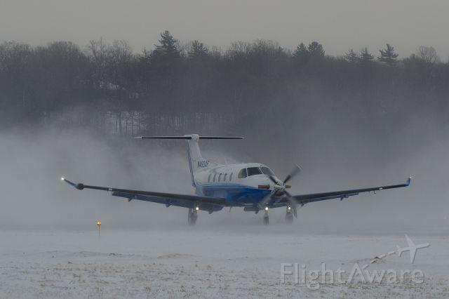 Pilatus PC-12 (N493AF) - Landing on Runway 26 in gusty crosswinds and blowing snow