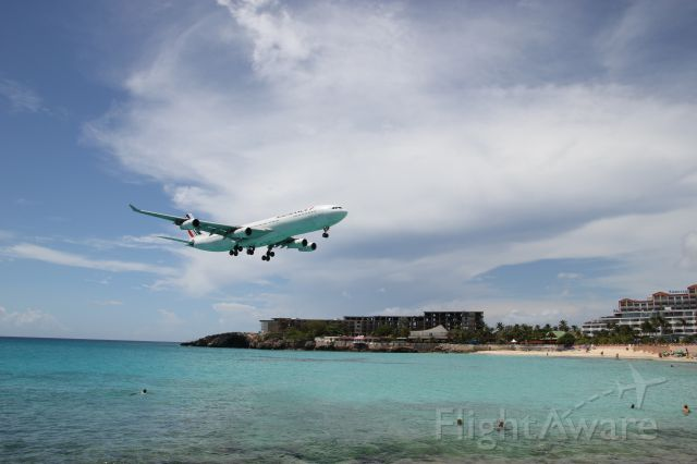 Airbus A340-300 (F-GLZP) - Air France A340 on final at Princess Juliana Airport St Martin. Maho Beach.