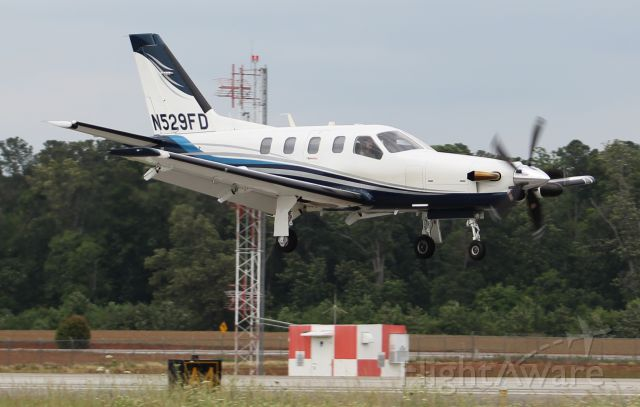 Socata TBM-850 (N529FD) - A Socata TBM 850 arriving Runway 18 at Pryor Field Regional Airport, Decatur, AL - May 27, 2017.
