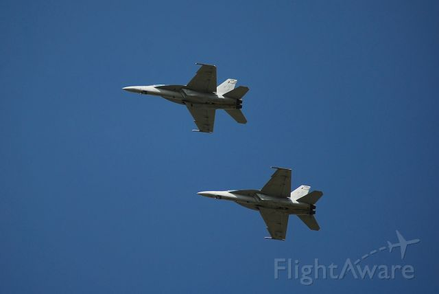 — — - Two F-18F Super Hornets landing at Whiteman AFB for a fuel stop.