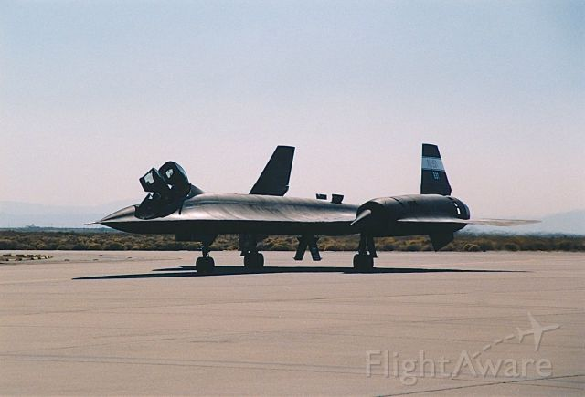 Lockheed Blackbird (NASA831) - NSAS SR-71 taxing by the crowd line at the USAF Edwards AFB Open House and Air Show 10-18-1997. As the SR-71 taxied by you could feel the heat generated by the super sonic fly by that they did.