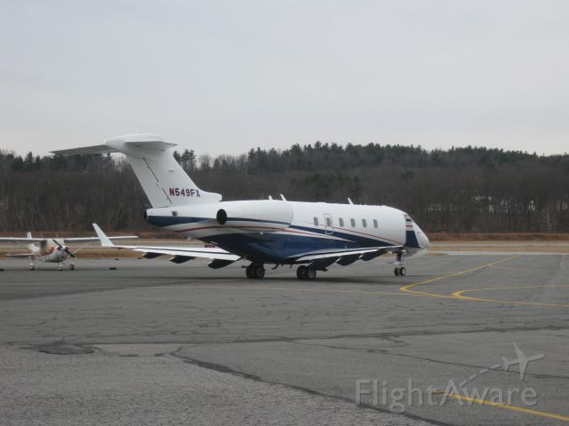 Bombardier Challenger 300 (N549FX) - Taxiing out to runway 14.