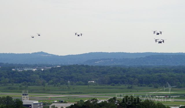 Bell V-22 Osprey — - MORRISTOWN, NEW JERSEY, USA-AUGUST 14, 2020: On a cloudy and overcast day, Marine One (one of the Sikorsky helicopters) and her four escorts, are seen after taking off from Morristown Municipal Airport en route to New York City. The Marine One detachment this time consisted of two Sikorsky helicopters and three V-22 Osprey tilt-rotor aircraft. President Trump spent the weekend at his golf club in Bedminster, New Jersey but first flew to New York City to see his ailing brother. The Ospreys probably contained staff personnel and members of the press. Photo taken from approximately one mile away.