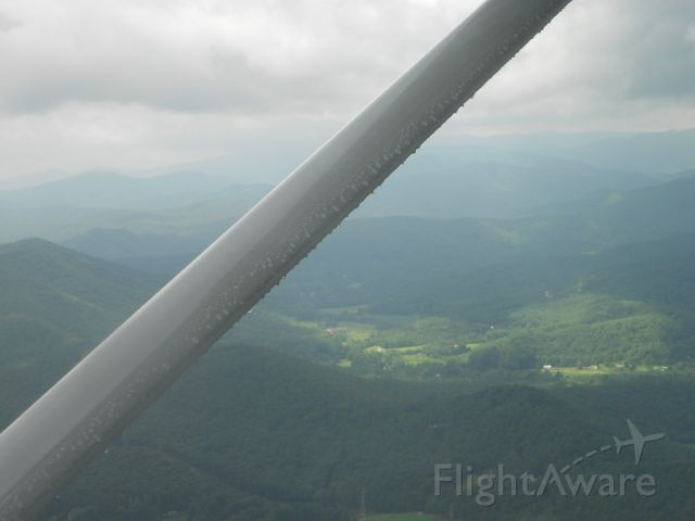 Cessna Skylane (N727CP) - Just flew through a storm and here is the water on the wings.  I think its pretty cool looking.