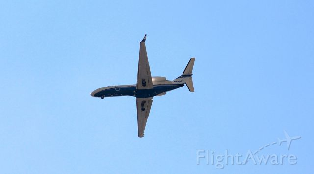 Cessna Citation CJ3 (N6BB) - Nice early morning shot from my front yard.
