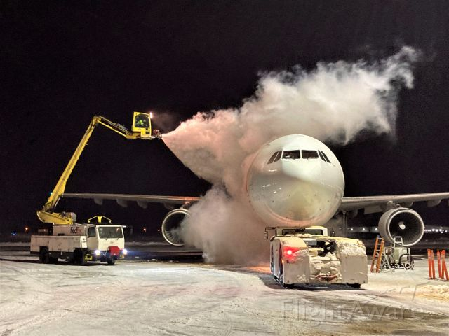"""Airbus A300F4-600 (N744FD) - FDX """"Grace"""" is getting the Deicing Treatment on 2-5-2021 at 8 pm.   0F & a brisk 15 mph wind. Departing shortly thereafter for the short Friday night hop to Milwaukee."""