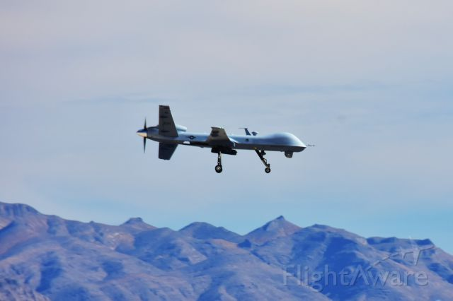 — — - MQ-1V unmanned aerial vehicle shooting touch and go at Creech AFB Indian Springs Nevada
