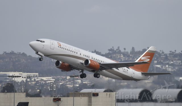 BOEING 737-400 (N802TJ) - Departing LAX on 25R