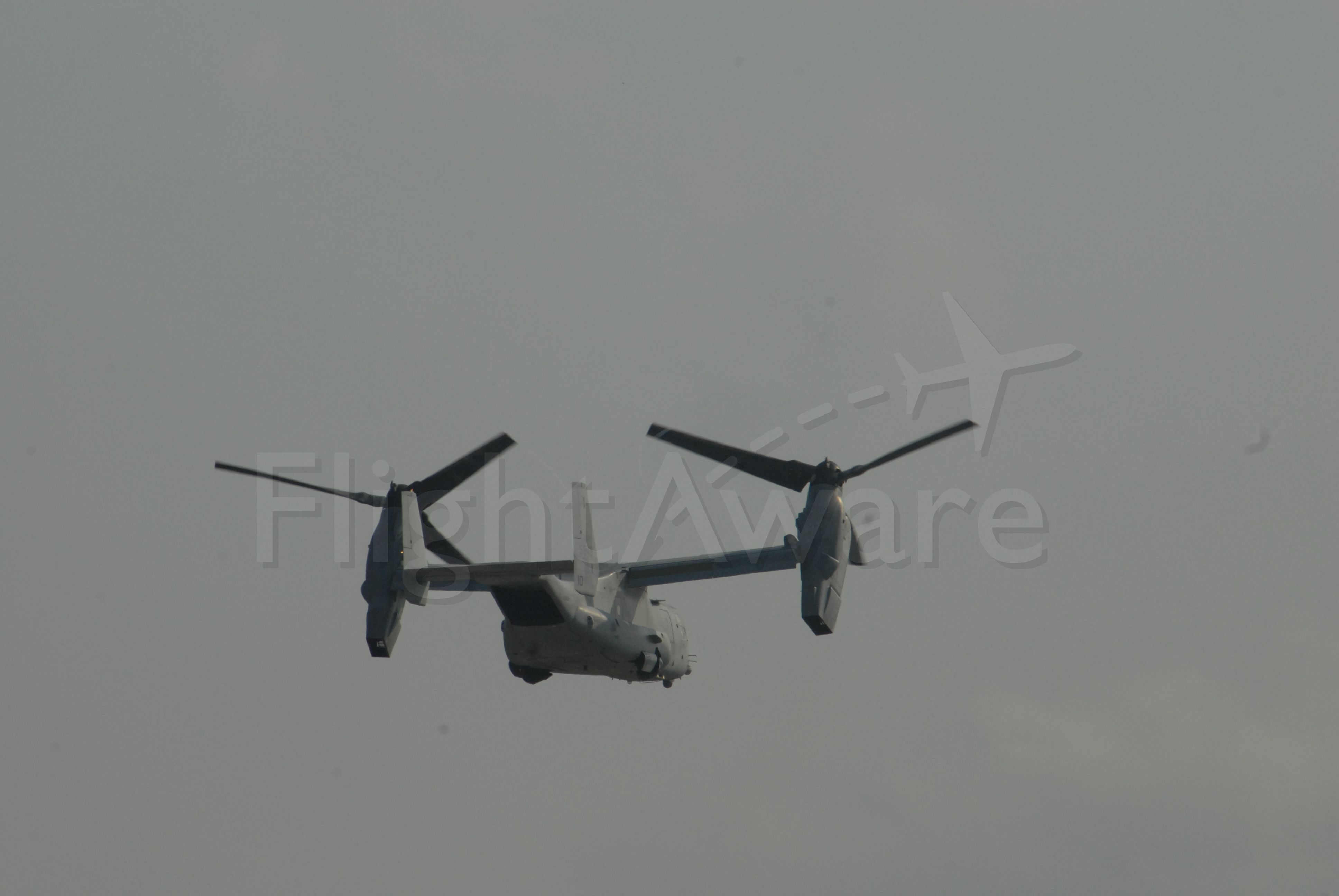 Bell V-22 Osprey — - After Vertical Take off, Gear almost up, Props traversing to forward thrust.