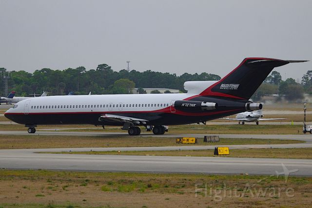 BOEING 727-200 (N727NK) - Roush Fenway 727 taxis for departure to KCLT after the Daytona 500.