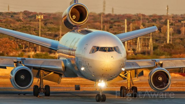 McDonnell Douglas DC-10 (N550FE) - Exiting 31L at Juliet with the last rays of sun for the day.