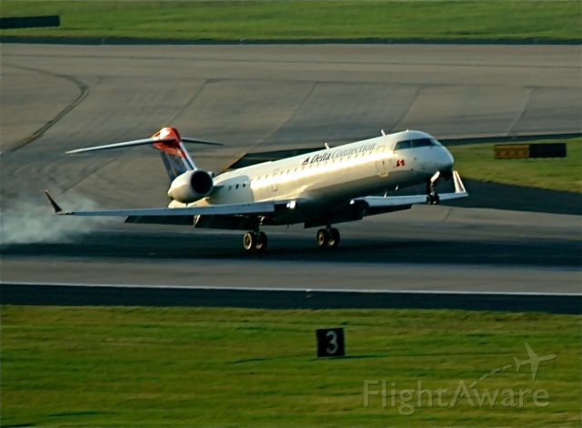 — — - early morning RJ arrival into KATL, taken from the balcony of the Renaissance Hotel..