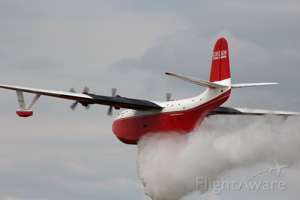 MARTIN Mars (C-FLYL) - And the Drop is On along the Runway at Oshkosh.