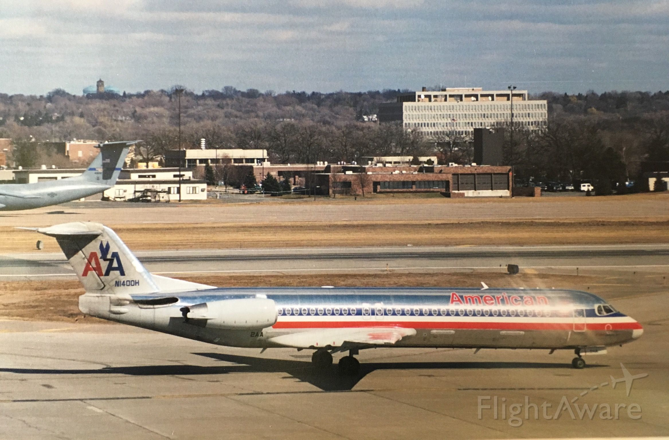 Fokker 100 (N1400H) - This is from around 1998-1999 from the observation deck at MSP.