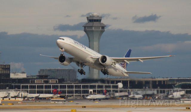BOEING 777-300ER (N2142U) - Departing 28R on Christmas Day, 2020.
