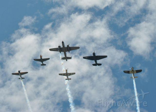 — — - A formation at Sun N Fun:  A6N Zero (not a replica), P-40 Warhawk, B-25 Mitchell, P-51 Mustang, TBF Avenger, F4-U Corsair