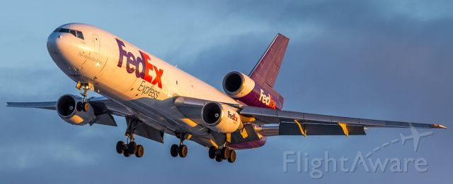 McDonnell Douglas DC-10 (N315FE) - Out early to catch some nice light at sunrise. Here a FEDEX DC10 lines up for runway 23 at YYZ