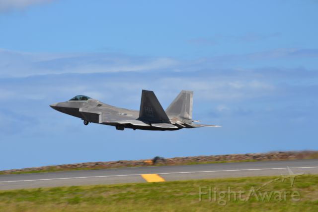 Lockheed F-22 Raptor — - A F-22 taking off from Honolulu from reef runway.