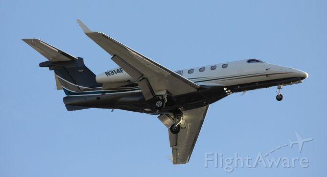 Embraer Phenom 300 (N314FL) - Arrival 30R, from KLAS  06-02-2015