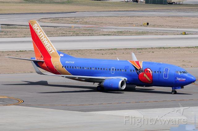 BOEING 737-300 (N647SW) - Triple Crown arriving from Love Field