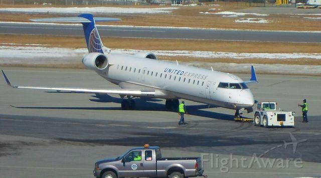 N159GJ — - A United Express (GoJet Airlines) CRJ 600 pulls away from the gate and prepares for departure at KALB.