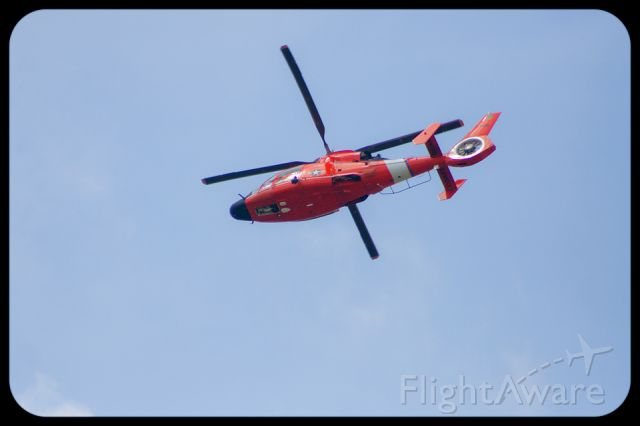 — — - United States Coast Guard MH-65 Helicopter flies over Charleston, S.C.