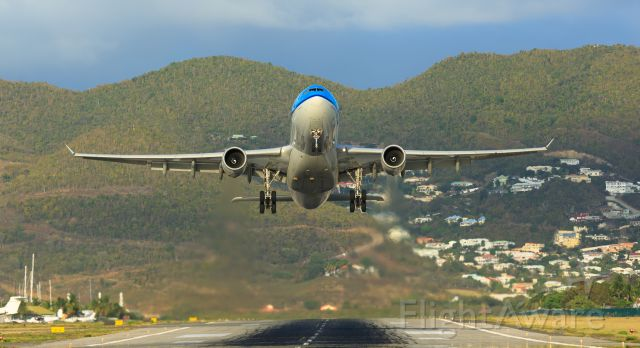 Airbus A330-200 (PH-AOM) - KLM PH-AOM departing TNCM St Maarten from runaway 28 to the Netherlands.
